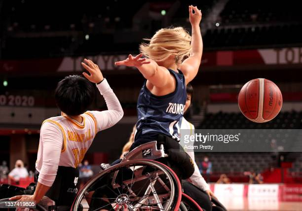 Madeleine Thompson of Team Great Britain competes for a loose ball with Xialian Huang of Team China in the second half in the women's Wheelchair...