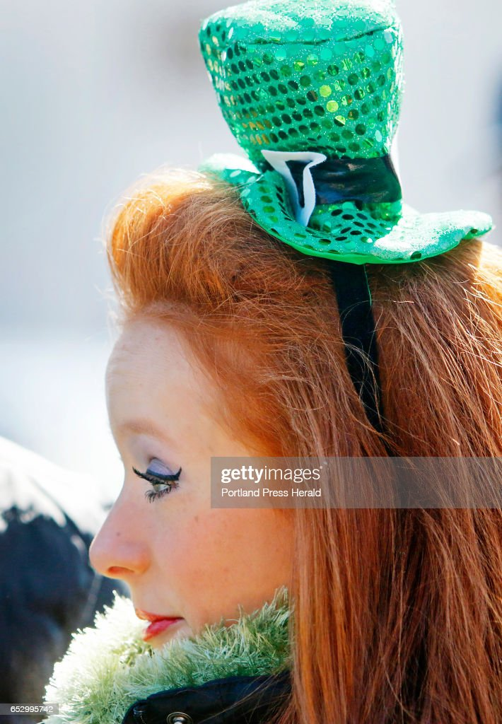 Madeleine Walsh of Saco tries to keep warm while waiting to march with Stillson School of Irish Dance in the Irish American Club's annual St. Patrick's Parade on Commercial Street.