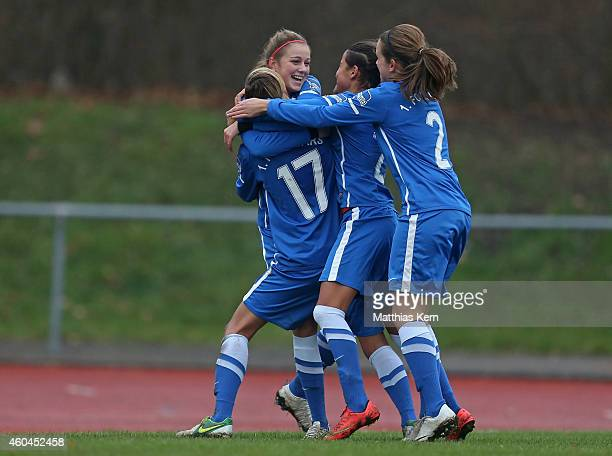 Madeleine Wojtecki of Luebars jubilates with team mates after scoring the second goal during the Women's Second Bundesliga match between 1FC Luebars...