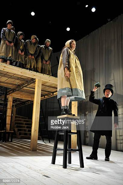 Madeleine Worrall as Jane Eyre and Craig Edwards as Mr Brocklehurst with artists of the company in an adaptation of Charlotte Bronte's Jane Eyre...