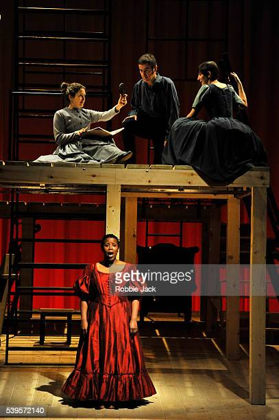 Madeleine Worrall as Jane Eyre and Melanie Marshall as Bertha Mason with artists of the company in an adaptation of Charlotte Bronte's Jane Eyre...