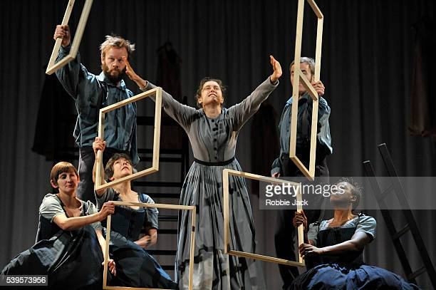 Madeleine Worrall as Jane Eyre with artists of the company in an adaptation of Charlotte Bronte's Jane Eyre directed by Sally Cookson at the National...