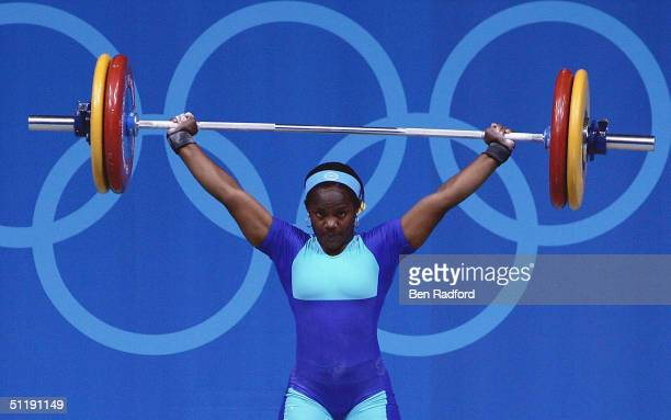 Madeleine Yamechi of Cameroon competes in the snatch portion the women's 69 kg category weightlifting competition on August 19 2004 during the Athens...