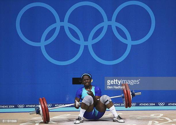 Madeleine Yamechi of Cameroon drops the bar on top of herself during the clean and jerk portion of the women's 69 kg category weightlifting...