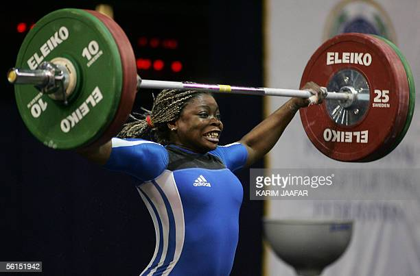 Madeleine Yamechi of Cameroon lifts during the women's 75 kilos category at the Centennial World Weightlifting championship in Doha 13 November 2005...