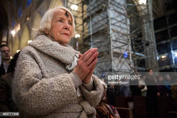 Madeleine Zohn who has been attending St Patrick's for 55 years worships during Mass on Ash Wednesday at St Patrick's Catherdral on February 18 2015...