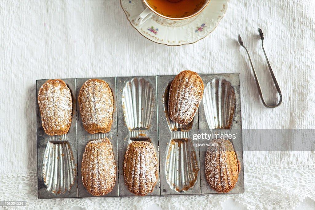 Madeleines with tea : Stock Photo