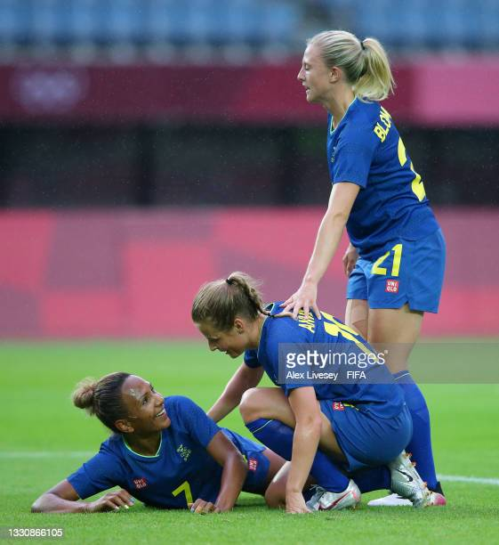 Madelen Janogy of Team Sweden celebrates with team mates after scoring their side's second goal during the Women's Group G match between New Zealand...