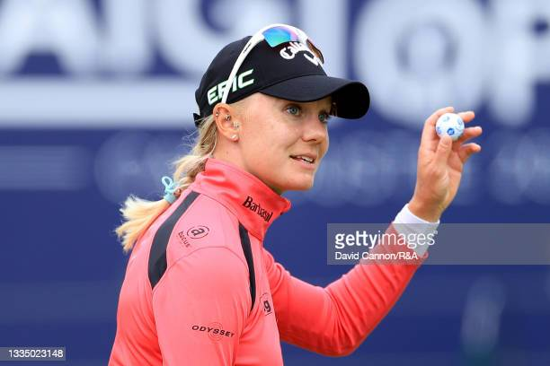 Madelene Sagstrom of Sweden acknowledges the crowd following a bogey on the eighteenth hole during Day One of the AIG Women's Open at Carnoustie Golf...