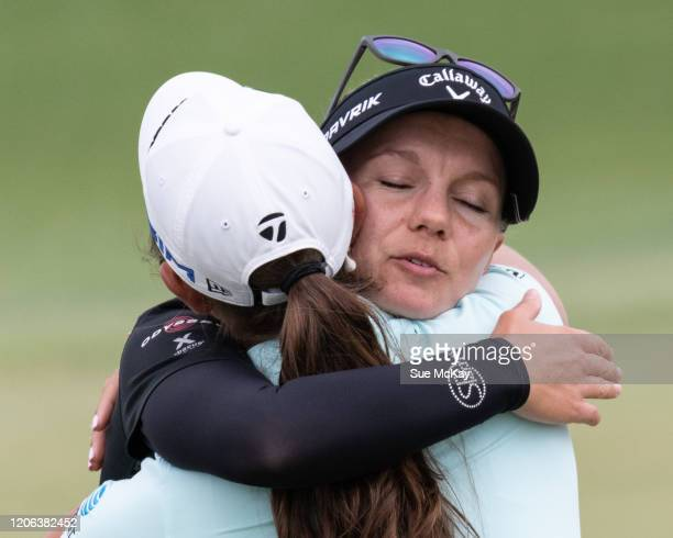 Madelene Sagstrom of Sweden and Maria Fassi of Mexico embrace at the end of day three of the 2020 ISPS HANDA Women's Australian Open at Royal...
