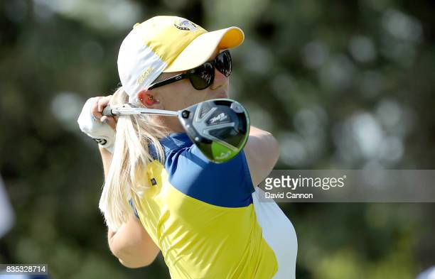 Madelene Sagstrom of Sweden and the European Team plays her tee shot on the 12th hole in her match with Jodi Ewart Shadoff against Michelle Wie and...