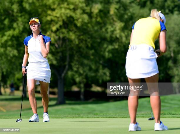 Madelene Sagstrom of Team Europe reacts the the missed putt of Jodi Ewart Shadoff on the ninth green during the afternoon fourball matches of the...