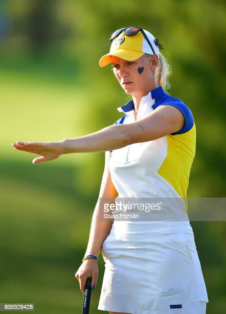 Madelene Sagstrom of Team Europe reacts to a putt during the afternoon fourball matches of The Solheim Cup at Des Moines Golf and Country Club on...