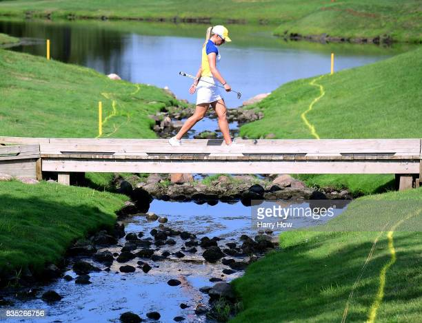 Madelene Sagstrom of Team Europe walks to the ninth green trailing Team USA during the afternoon fourball matches of the Solheim Cup at the Des...