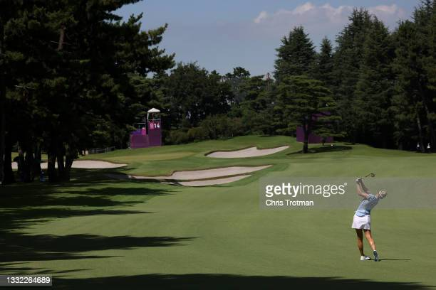 Madelene Sagstrom of Team Sweden plays her second shot on the 14th hole during the first round of the Women's Individual Stroke Play on day twelve of...