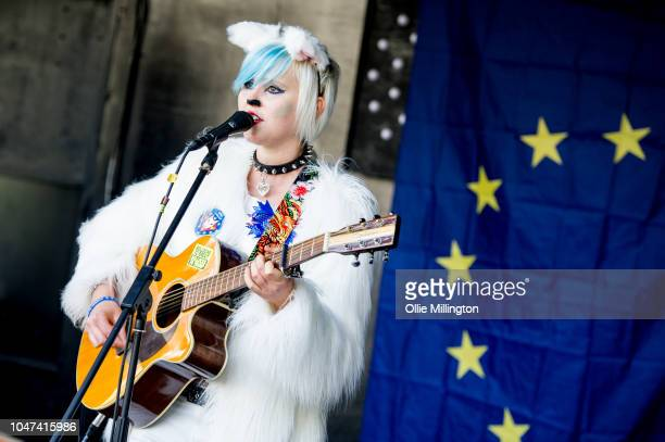 Madelina Kay performs to the crowd at Parliment Square as thousands of dog owners and their dogs march through central London to Parliament on an...