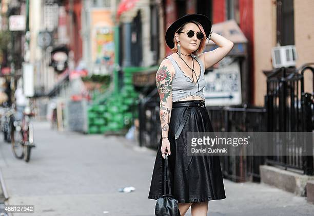 Madeline Dawson is seen in the East Village wearing a Hollister tank top and bra Forever 21 skirt belt and hat vintage sunglasses vintage necklace...