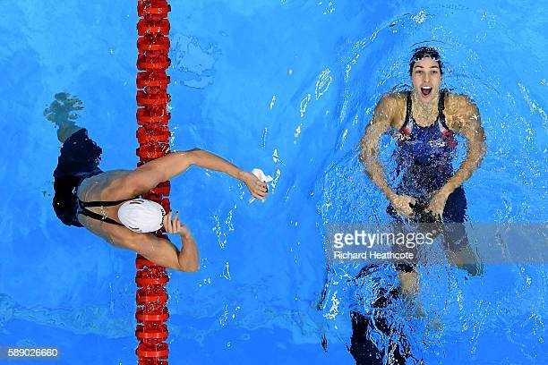 Madeline Dirado of the United States celebrates will gold ahead of Katinka Hosszu of Hungary in the Women's 200m Backstroke Final on Day 7 of the Rio...