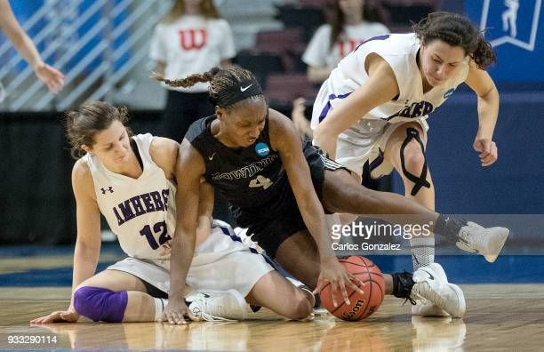 Madeline Eck of Amherst College and Taylor Choate of Bowdoin fought for a loose ball during the Division III Women's Basketball Championship held at...