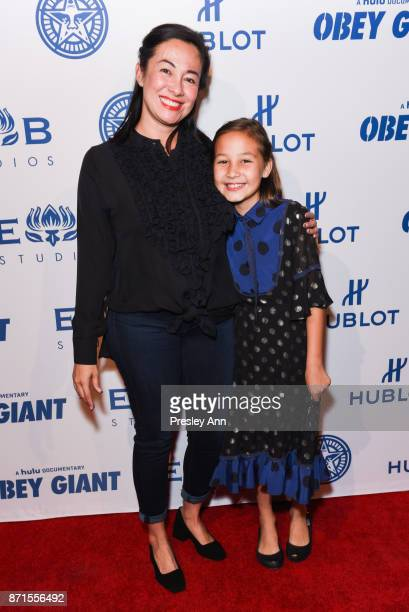 Madeline Fairey and Amanda Fairey attend Photo Op For Hulu's 'Obey Giant' at The Theatre at Ace Hotel on November 7 2017 in Los Angeles California