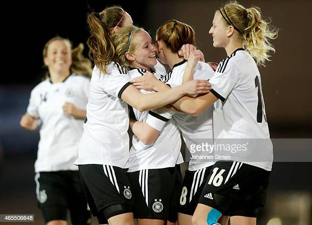 Madeline Gier of Germany celebrates with team mates after scoring her team's first goal during the women's U19 international friendly match between...
