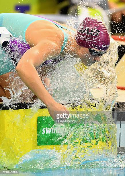 Madeline Groves of Australia sprays herself with water before competing in the Women's 200 Metre Butterfly during day four of the Australian Swimming...