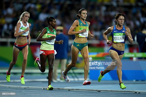 Madeline Heiner Hills and Shelby Houlihan of the United States compete in the Women's 5000m Final on Day 14 of the Rio 2016 Olympic Games at the...