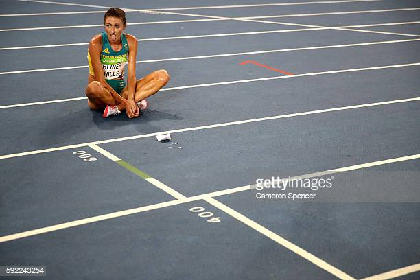 Madeline Heiner Hills of Australia reacts after the Women's 5000m Final and setting a new Olympic record of 142617 on Day 14 of the Rio 2016 Olympic...