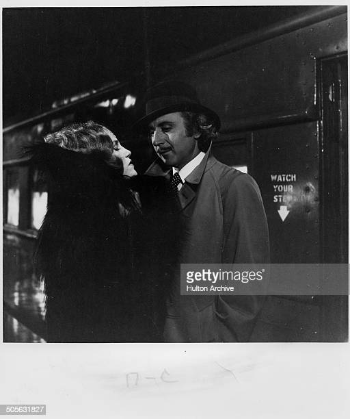 Madeline Kahn talks with Gene Wilder at the train station in a scene from the movie Young Frankenstein circa 1974