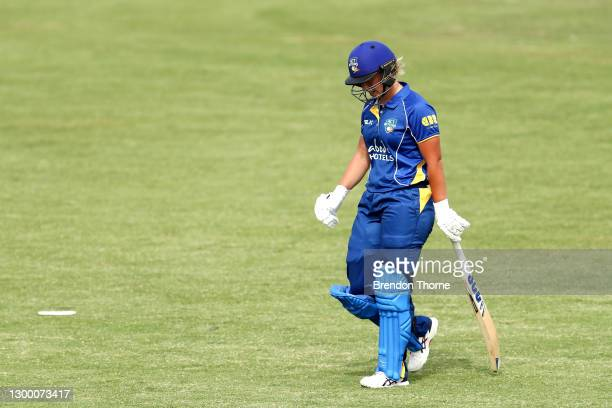 Madeline Penna of the Meteors walks from the field after being dismissed by Amy Smith of the Tigers during the WNCL match between Tasmania and ACT at...