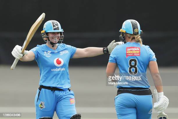 Madeline Penna of the Strikers celebrates with Tegan McPharlin of the Strikers after hitting a half century during the Women's Big Bash League WBBL...