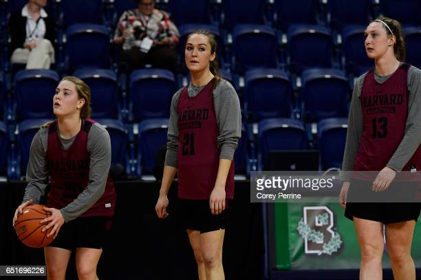 Madeline Raster Taylor Finley and Jeannie Boehm of the Harvard Crimson prepare to shoot the ball during a shoot around practice in preparation for...