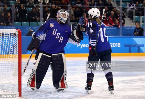 Madeline Rooney fist bumps Brianna Decker of the United States before the Women's Gold Medal Game against Canada on day thirteen of the PyeongChang...