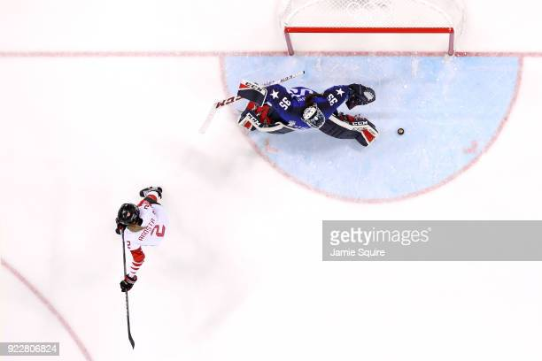 Madeline Rooney of the United States makes a save against Meghan Agosta of Canada in a shootout during the Women's Gold Medal Game on day thirteen of...