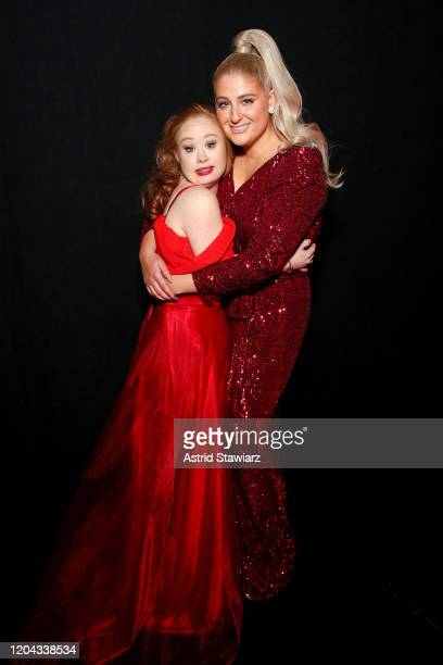 Madeline Stuart and Meghan Trainor pose backstage at The American Heart Association's Go Red for Women Red Dress Collection 2020 at Hammerstein...