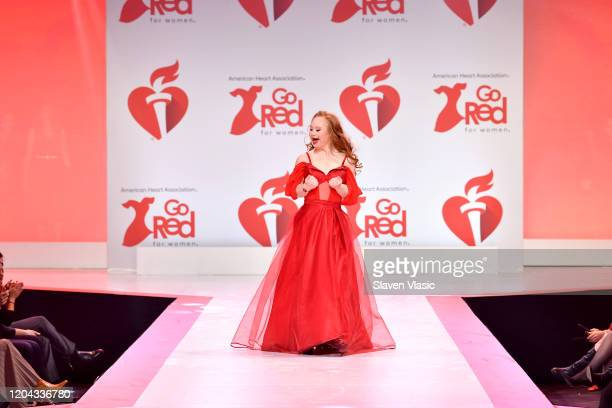 Madeline Stuart walks the runway at The American Heart Association's Go Red for Women Red Dress Collection 2020 at Hammerstein Ballroom on February...