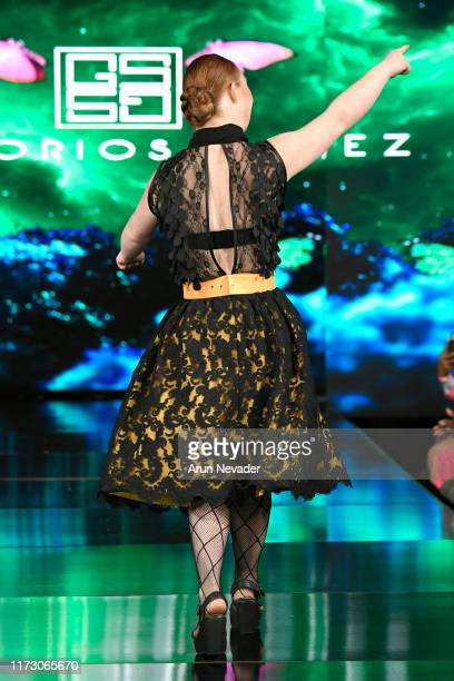 Madeline Stuart walks the runway during GREGORIO SANCHEZ At New York Fashion Week Powered by Art Hearts Fashion NYFW September 2019 at The Angel...