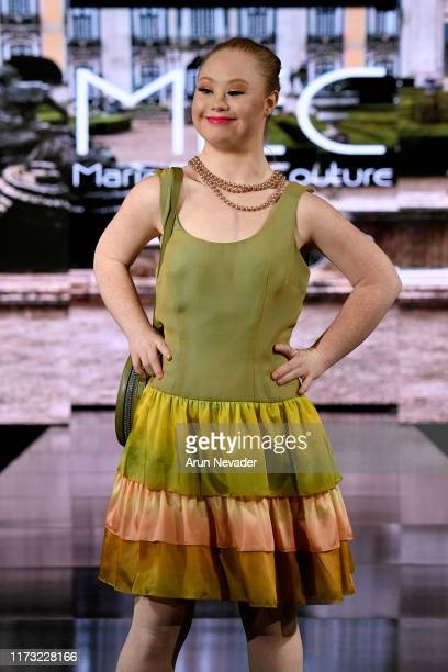 Madeline Stuart walks the runway during MARIA ELENA COUTURE At New York Fashion Week Powered by Art Hearts Fashion NYFW September 2019 at The Angel...