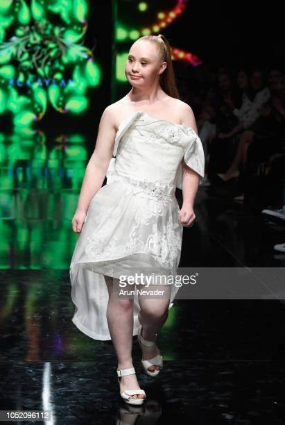 Madeline Stuart walks the runway wearing RC Caylan at Los Angeles Fashion Week Powered by Art Hearts Fashion LAFW SS/19 at The Majestic Downtown on...