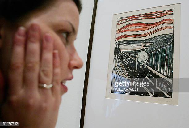 Madeline Wilson from the National Gallery of Victoria inspects Edvard Munch's famous handcoloured lithograph version of 'The Scream' which is one of...