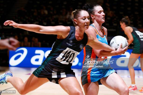 Madeline Woods of the Giants and Sharni Lambden compete for the ball during the round three Australian Netball League match between the Magpies and...