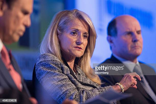 Madelyn Antoncic vice president and treasurer of the World Bank Group center gestures as she speaks during the Milken Institute London summit in...