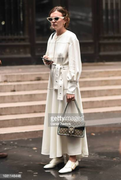 Madelyn Furlong is seen wearing a white jacket and skirt and Gucci bag outside the Proenza Schouler show during New York Fashion Week Women's S/S...