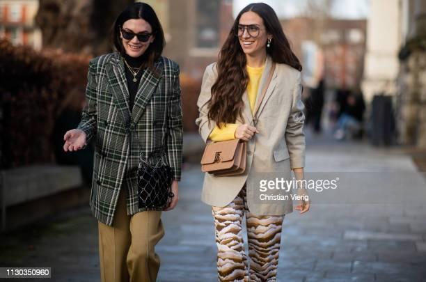Madelynn Furlong is seen wearing green plaid blazer beige pants and Erika Boldrin wearing grey blazer flared pants with print outside Victoria...