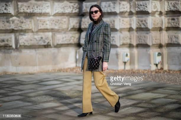 Madelynn Furlong is seen wearing green plaid blazer beige pants outside Victoria Beckham during London Fashion Week February 2019 on February 17 2019...