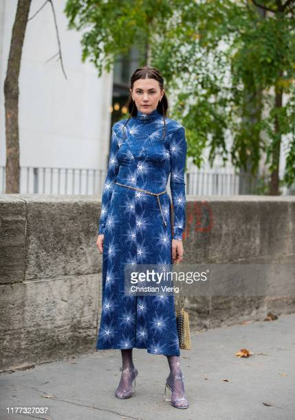Madelynn Furlong seen wearing blue dress with print, sheer tights, heels, bag outside Paco Rabanne during Paris Fashion Week Womenswear Spring Summer...