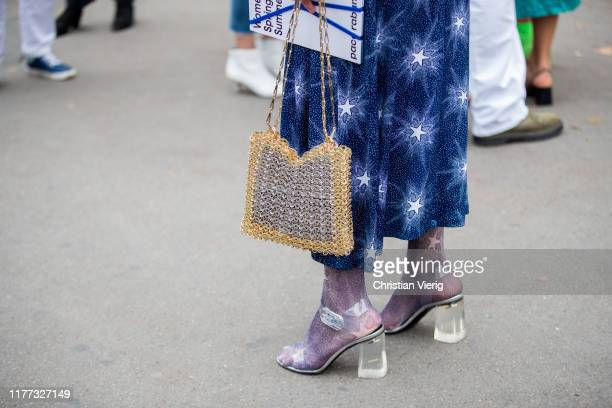 Madelynn Furlong seen wearing blue dress with print sheer tights heels bag outside Paco Rabanne during Paris Fashion Week Womenswear Spring Summer...