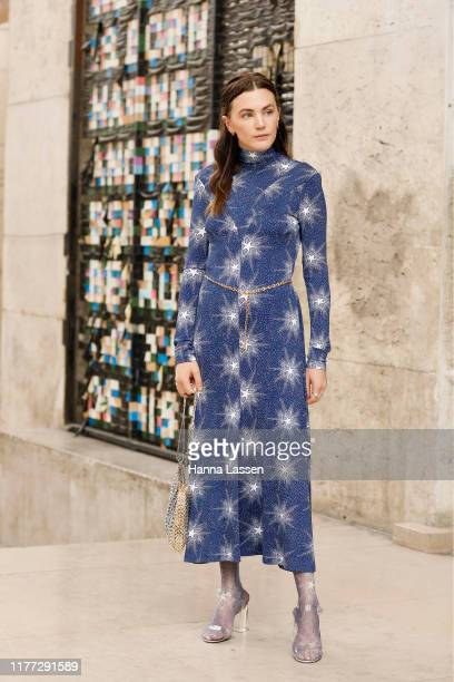 Madelynn Furlong wearing navy dress outside Paco Rabanne during Paris Fashion Week Womenswear Spring Summer 2020 on September 26 2019 in Paris France