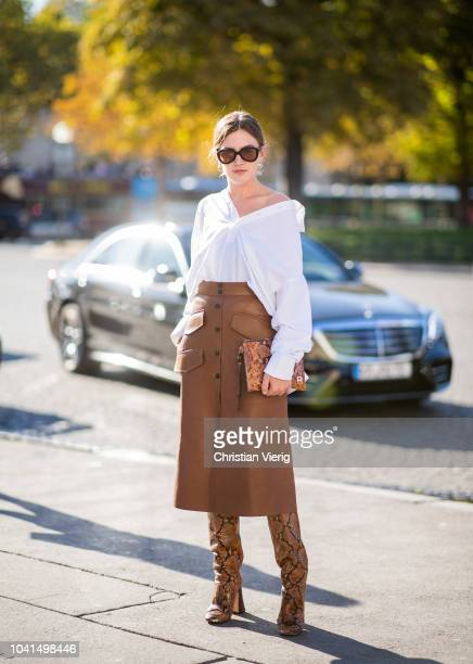 Madelynn Furlong wearing white blouse brown leather skirt boots and bag with snake print is seen outside Rochas during Paris Fashion Week Womenswear...