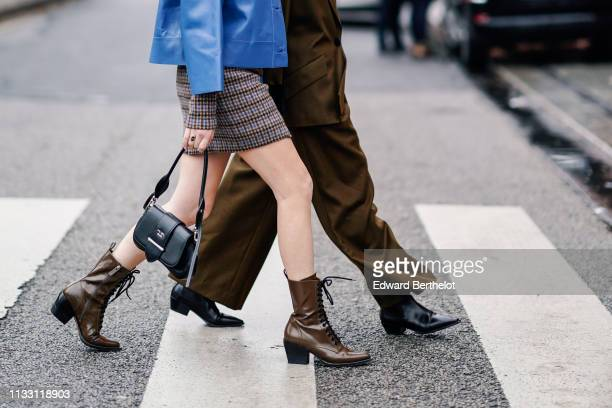 Madelynn Furlong wears a brown and blue tweed dress a lavenderblue leather jacket a black Prada bag brown pointy laceup boots Erika Boldrin wears a...